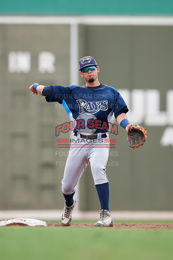 GCL Rays second baseman Cristhian Pedroza (19) throws to first base during a game against the GCL Red Sox on August 1, 2018 at JetBlue Park in Fort Myers, Florida.  GCL Red Sox defeated GCL Rays 5-1 in a rain shortened game.  (Mike Janes/Four Seam Images)