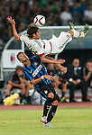 Andrea Poli of AC Milan competes for the ball with Baldini Enrico of FC Internazionale Milano during the AC Milan vs FC Internazionale Milano as part of the International Champions Cup 2015 at the Longgang Stadium on 25 July 2015 in Shenzhen, China. Photo by Hendrik Frank / Power Sport Images