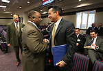 Nevada Assemblyman Jason Frierson, D-Las Vegas, greets Gov. Brian Sandoval at the Legislative Building in Carson City, Nev., on Thursday, Feb. 21, 2013..Photo by Cathleen Allison