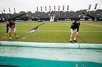 Netherlands, Den Bosch, 18.06.2014. Tennis, Topshelf Open, Kidsday, Overall view Centercourt being covered due to rain<br /> Photo:Tennisimages/Henk Koster