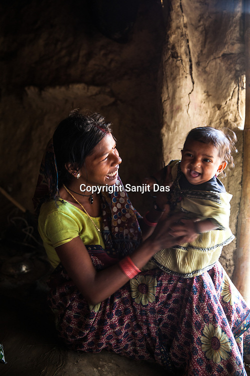 Anita Devi holds her 7 month daughter, Nisha in her house in Joganiya B in Saptari, Nepal. Nisha was refered by a female health worker and was diagnosed on Feb 12, 2014. MUAC - 85 mm, Weight - 4kg, and Height - 56.5 cm.