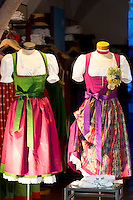 Traditional Tyrolean dirndl dresses in shop window in Herzog Friedrich Strasse in Innsbruck in the Tyrol, Austria
