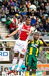 Nederland, Den Haag, 23 september  2012.Seizoen 2012/2013.Eredivisie.Ado Den Haag-Ajax.Ricardo van Rijn van Ajax in duel om de bal met Rydell Poepon van Ado den Haag..
