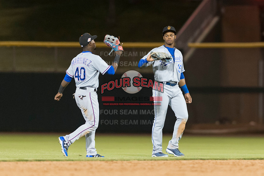 Surprise Saguaros outfielders Julio Pablo Martinez (40) and Khalil Lee (15) celebrate a victory after an Arizona Fall League game against the Scottsdale Scorpions at Scottsdale Stadium on October 15, 2018 in Scottsdale, Arizona. Surprise defeated Scottsdale 2-0. (Zachary Lucy/Four Seam Images)