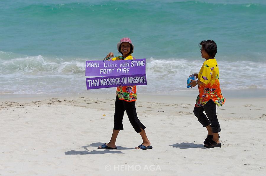 Hat Chaweng (beach). Central Samui Beach Resort. Locals offering Thai Massage.