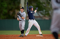 Bethel Wildcats Parker Mullenbach (22) celebrates a double as second baseman Bryan Niznik (2) waits for the throw in during the second game of a double header against the Edgewood Eagles on March 15, 2019 at Terry Park in Fort Myers, Florida.  Bethel defeated Edgewood 3-2.  (Mike Janes/Four Seam Images)