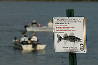 A sign at a boat ramp notifies fishermen of a $100 reward for returning saugeye tagged for research at Hoover Reservoir in Columbus, Ohio. The fish is part of a three year study of fish habitat at Hoover Reservoir.