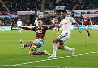 Pictured: Neil Taylor of Swansea is tackled by Carl Jenkinson of West Ham Saturday 10 January 2015<br />