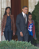 United States President Barack Obama, center, flanked by daughters Malia, left, and Sasha, right, depart the Oval Office to participate in the annual White House ritual of granting a Presidential Pardon to the National Thanksgiving Turkey in the Rose Garden of the White House in Washington, D.C. on Wednesday, November 21, 2012.  This year's turkey, Cobbler, is 19-weeks old and weighs 40 pounds (18kg).  Cobbler, and his alternate, Gobbler, were named from submissions from elementary schools in Rockingham County, Virginia, where the turkeys were raised.  Following the pardoning ceremony, Cobbler and Gobbler will live out their lives at George Washington's Mount Vernon Estate and Gardens in Mount Vernon, Virginia.  .Credit: Ron Sachs / CNP