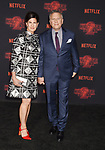 WESTWOOD, CA - OCTOBER 26: Actress Paula Ravets (L) and actor Paul Reiser arrive at the Premiere Of Netflix's 'Stranger Things' Season 2 at Regency Westwood Village Theatre on October 26, 2017 in Los Angeles, California.