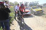 DS Marc Sergeant pushes Jens Debusschere (BEL) Lotto-Soudal after a wheel change on pave sector 29  Troisvilles a Inchy during the 115th edition of the Paris-Roubaix 2017 race running 257km Compiegne to Roubaix, France. 9th April 2017.<br /> Picture: Eoin Clarke | Cyclefile<br /> <br /> <br /> All photos usage must carry mandatory copyright credit (&copy; Cyclefile | Eoin Clarke)