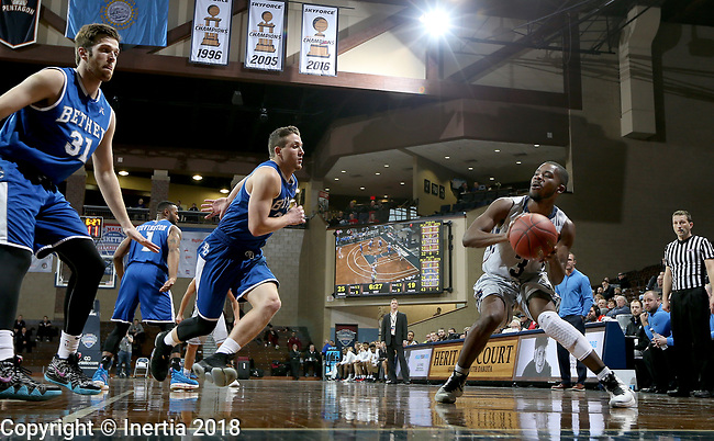 SIOUX FALLS, SD - MARCH 7:  Elbert Lawrence #3 from Oklahoma Wesleyan controls the ball against Tanner Shepherd #24 from Bethel at the 2018 NAIA DII Men's Basketball Championship at the Sanford Pentagon in Sioux Falls. (Photo by Dave Eggen/Inertia)