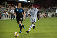 SAN JOSE,  - AUGUST 31: Jackson Yueill #14 of the San Jose Earthquakes and Carlos Ascues #26 of the Orlando City SC during a game between Orlando City SC and San Jose Earthquakes at Avaya Stadium on September 1, 2019 in San Jose, .