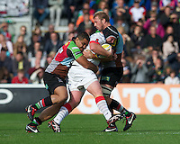 Matt Stevens of Saracens is wrapped up by Maurie Fa'asavalu (left) and Chris Robshaw of Harlequins during the Aviva Premiership match between Harlequins and Saracens at the Twickenham Stoop on Sunday 30th September 2012 (Photo by Rob Munro)