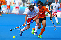 Englands Chris Griffiths and Malaysia's Faizal Saari compete for the ball during the Hockey World League Semi-Final Pool A match between England and Malaysia at the Olympic Park, London, England on 17 June 2017. Photo by Steve McCarthy.