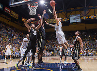 California's Justin Cobbs shoots for the basket during over time against Colorado at Haas Pavilion in Berkeley, California on March 8th, 2014. California defeated Colorado 66 - 65