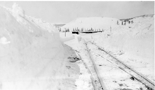 Deep snow cut at Cumbres station with switch rails cleaned out.<br /> D&amp;RGW  Cumbres, CO