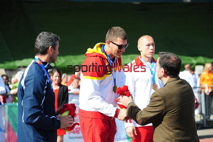 IPC European Athletics Championship 2014<br /> Swansea University<br /> <br /> Medal ceremony: Men's javelin throw F12.<br /> Gold medal: Hector Cabrera Llacer (ESP)<br /> Silver medal: Milos Grlica (SRB)<br /> Bronze medal: Marek Wietecki (POL)<br /> <br /> 23.08.14<br /> Chris Vaughan-SPORTINGWALES