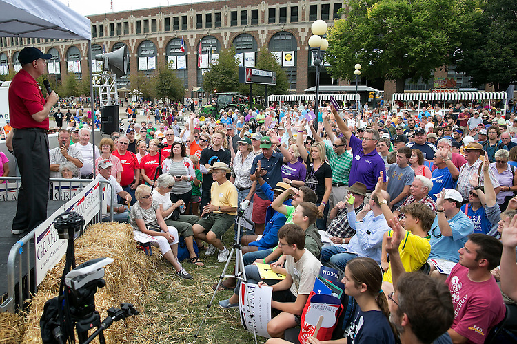 UNITED STATES - August 17: Fairgoers raise their hand when asked if they support increasing spending towards  alzheimer's research as Republican presidential candidate Sen. Lindsey Graham, R-S.C., speaks at to fairgoers at The Des Moines Register Presidential Soap Box at the Iowa State Fair in Des Moines, Iowa, Monday, August 17, 2015. (Photo By Al Drago/CQ Roll Call)