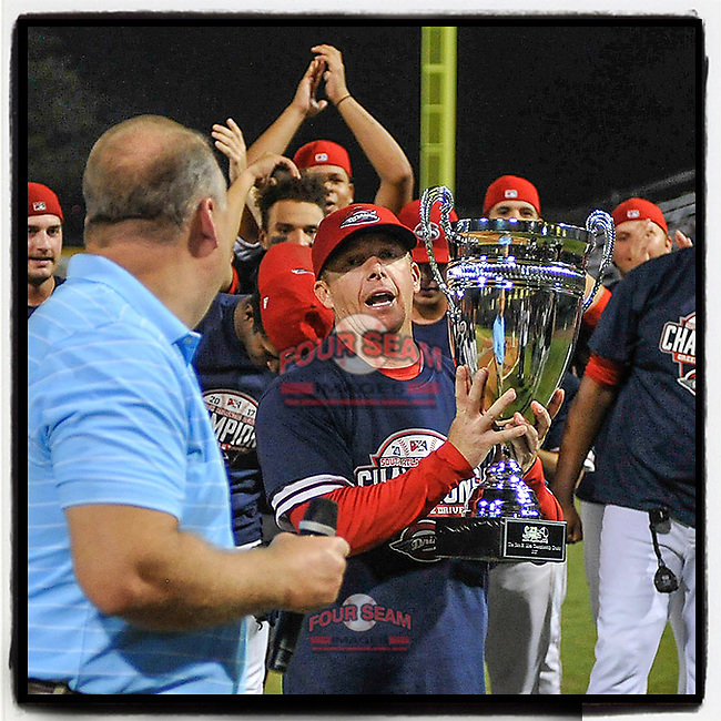 Greenville Drive players celebrate their 2017 South Atlantic League Championship as manager Darren Fenster accepts the trophy following an 8-3 win over the Kannapolis Intimidators in Game 4 of the Championship Series on Friday, September 15, 2017, at Fluor Field at the West End in Greenville, South Carolina. It was Greenville's first SAL Championship. Greenville won the series 3-1. (Tom Priddy/Four Seam Images)