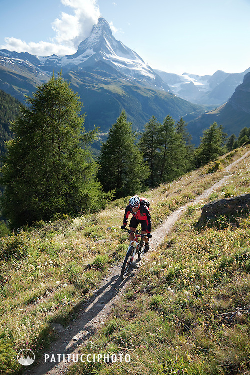 Mountain biking in the Zermatt area of the Swiss Alps with the Matterhorn in the background
