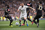 Karim Benzema of Real Madrid (in white) fights for the ball with Kalidou Koulibaly of SSC Napoli and his teamates Raul Albiol and Amadou Diawara (in black) during the match Real Madrid vs Napoli, part of the 2016-17 UEFA Champions League Round of 16 at the Santiago Bernabeu Stadium on 15 February 2017 in Madrid, Spain. Photo by Diego Gonzalez Souto / Power Sport Images
