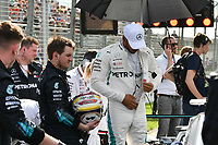 March 25, 2018: Lewis Hamilton (GBR) #44 from the Mercedes AMG Petronas Motorsport team puts on his race suit on the grid prior to the start of the 2018 Australian Formula One Grand Prix at Albert Park, Melbourne, Australia. Photo Sydney Low