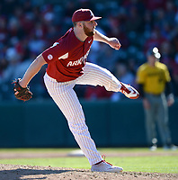 NWA Democrat-Gazette/ANDY SHUPE<br /> Arkansas closer Matt Cronin follows through with a pitch against Missouri Saturday, March 16, 2019, during the ninth inning at Baum-Walker Stadium in Fayetteville. Visit nwadg.com/photos to see more photographs from the game.