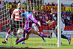 Doncaster Rovers v Oldham Athletic<br /> 30.8.2014<br /> Sky Bet League One<br /> Picture Shaun Flannery/Trevor Smith Photography<br /> Jonson Clarke-Harris (right) beats Rovers keeper Jed Steer to score the first goal of the game.