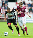 Pars' Ryan Wallace holds off Arbroath's Colin Hamilton.