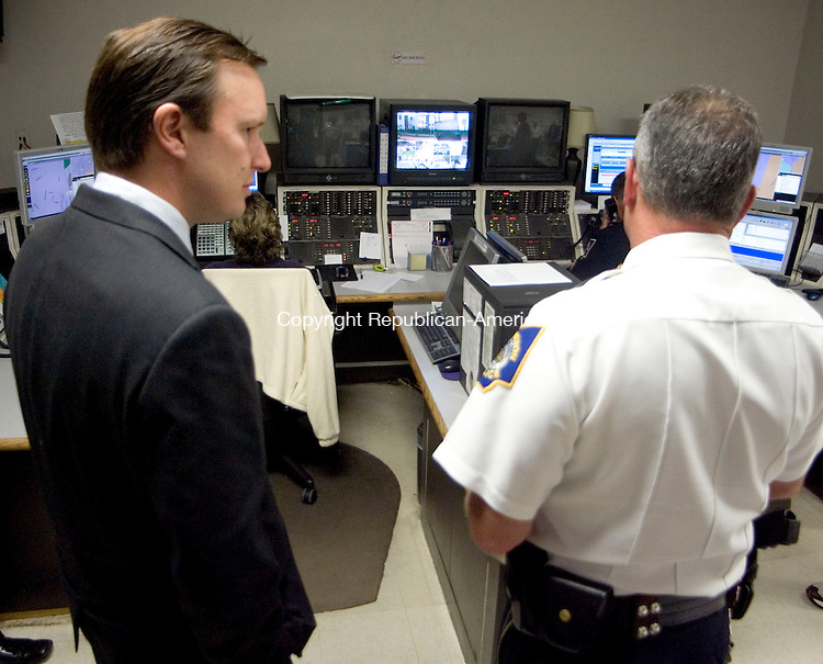 TORRINGTON, CT- 12 AUGUST 2008- 081208JT09-<br /> U.S. Rep. Chris Murphy (D-5th) speaks to Torrington Police Chief Robert Milano about the city's current communications equipment from inside the police department dispatch center on Tuesday. Fire Chief John Field, Emergency Management Director Tom Vannini, and Campion Ambulance Director of Northwest Operation Fred V. Rosa, as well as Milano, met with Murphy at Mayor Ryan Bingham's office to discuss funding for the city's public safety radio system, which is nearly 20 years old, before traveling to the police department to get a view of the town's current communication equipment.<br /> Josalee Thrift / Republican-American