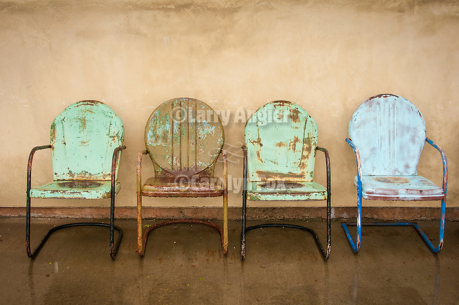Four metal lawn chairs at Cooper Winery, Shenandoah Valley, Calif.