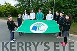 Rugby star Ciara Griffin  raises  the new Green Flag at Scoil Nuachabhail, Ballymac on Friday Pictured with the Green Flag committee l-r Aoife Reidy, Jill Quirke, Róisín Reidy, Ciara O'Shea, Shonagh Griffin, Roisin O'Rahilly, Niamh Rice and Holly Geary
