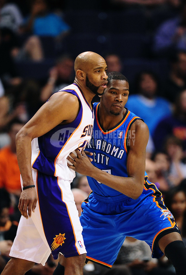 Mar. 30, 2011; Phoenix, AZ, USA; Oklahoma City Thunder forward (35) Kevin Durant against Phoenix Suns guard Vince Carter at the US Airways Center. Mandatory Credit: Mark J. Rebilas-