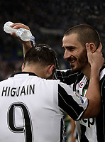 Football Soccer - Juventus - Lazio - Italian Cup Final - Olympic Stadium, Rome, Italy, May17,2017.<br /> Juventus' Leonardo Bonucci (r) and Gonzalo Higuain (l) celenbrate after winning the Italian Cup Final match at Rome's Olympic stadium, on May 17, 2017.<br /> UPDATE IMAGES PRESS/Isabella Bonotto