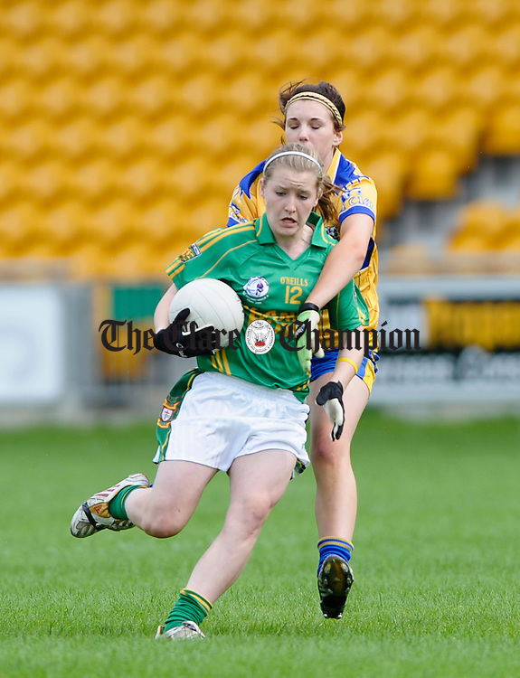 Donegal's Niamh Mc Laughlin is tackled by Clare's Katie Cahill during their All-Ireland U-18A Minor championship final at Tullamore. Photograph by John Kelly.