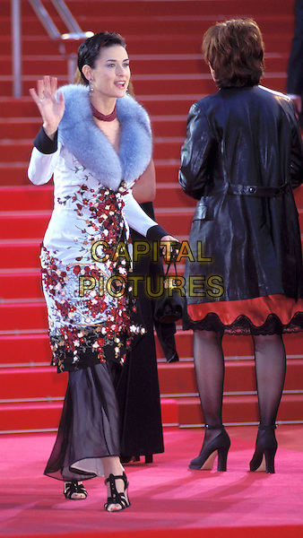 DEMI MOORE.Cannes Film Festival 1997.Ref: 026.full length, full-length, fur collar, flowery, floral print dress, coat, waving.www.capitalpictures.com.sales@capitalpictures.com.© Capital Pictures