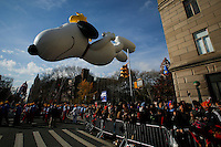 """the animated """"Peanuts"""" characters Snoopy and Woodstock balloon floats through the parade route during the 89th Macy's Thanksgiving Annual Day Parade in the Manhattan borough of New York.  11/26/2015. Eduardo MunozAlvarez/VIEWpress"""