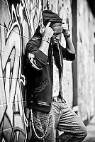 Male Model wears Urban Fashion Clothing against a grafitti wall