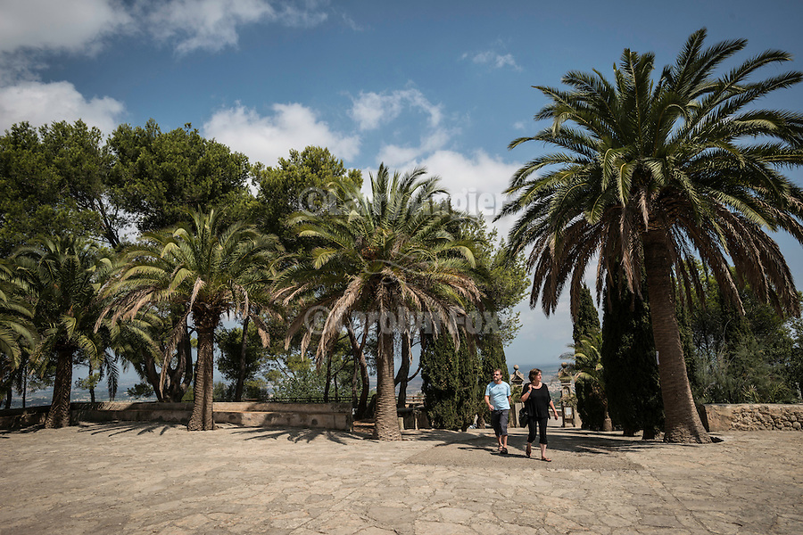 Palms at the entrance to Monastery of Bonany, Es Pla, Mallorca. Bonany was the site of the last sermon of Fr. Junipero Serra before leaving for the Mexico and California in 1735...Santuario de la Mare de Deú de Bonany was originally constructed in the XVII. century.