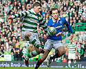 :: CELTIC'S GARY HOOPER TRIES TO GET AWAY FROM RANGERS' SASA PAPAC ::