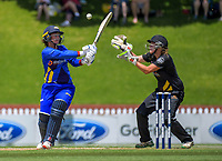 Katey Martin bats as keeper Jess McFadyen reacts during the women's Twenty20 cricket match between the Wellington Blaze and Otago Sparks at Basin Reserve in Wellington, New Zealand on Friday, 28 December 2018. Photo: Dave Lintott / lintottphoto.co.nz