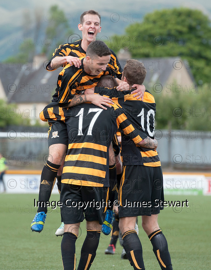 Alloa's Eddie Ferns (17) is congratulated by team mates after he scores their third goal.
