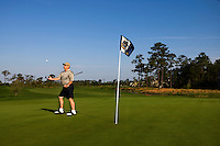A golfer throws up his ball after a putt in Charleston, SC.
