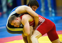 11 MAY 2014 - SHEFFIELD, GBR - Michael Grundy (bottom) attempts to overpower his opponent during their men's 74kg freestyle match at the British 2014 Senior Wrestling Championships at EIS in Sheffield, Great Britain (PHOTO COPYRIGHT © 2014 NIGEL FARROW, ALL RIGHTS RESERVED)