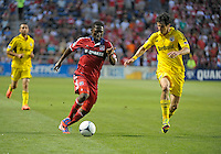 Chicago midfielder Patrick Nyarko (14) dribbles toward the Columbus goal while being defended by Columbus defender Nemanja Vukovic (32).  The Chicago Fire defeated the Columbus Crew 2-1 at Toyota Park in Bridgeview, IL on June 23, 2012.