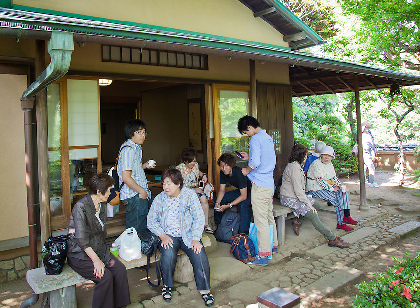 A group of visitors to Todoroki Valley enjoying a rest at a tea house.