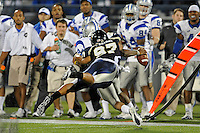 4 December 2010:  FIU defensive end Tourek Williams (97) tackles Middle Tennessee quarterback Dwight Dasher (9) in the second quarter as the Middle Tennessee State University Blue Raiders defeated the FIU Golden Panthers, 28-27, at FIU Stadium in Miami, Florida.