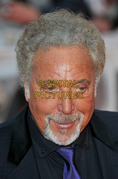 TOM JONES .Arrivals - 2009 Brit Awards, Earls Court, London, England, February 18th 2009..portrait headshot grey gray hair beard tanned orange face black shirt blue purple tie .CAP/PL.©PL/Capital Pictures