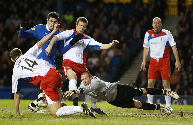 Ryan Esson dives to pluck the ball out of Kyle Lafferty's path